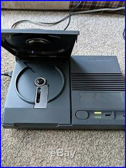 Amiga CD32 Console boxed with instructions games and controller