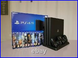 Playstation 4 (PS4) Pro, 1TB SSD, Black, Boxed, 2 Controllers, 10 Games & Stand