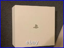 Sony PlayStation 4 Pro White 1TB Console with black controller boxed